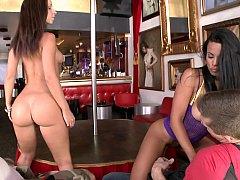 Two strippers beside head