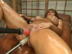 Oiled up ebony Ava Devine jumps on a fucking machine