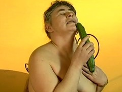 Lewd granny Julie moans thrash sing while fucking the brush vag with a cucumber
