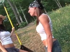 Smallholder girls with big tits play outdoors