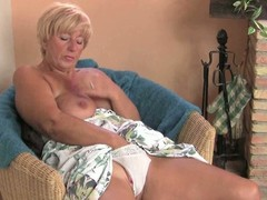 Big granny pleasures her cunt with a vibrator